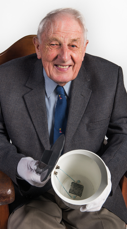 Ernie Norris holds an electric kettle made by Ralta