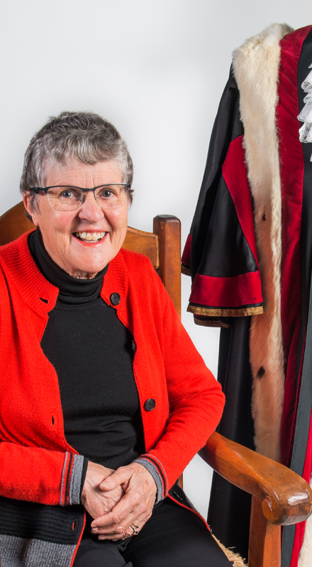 Former Palmerston North mayor Jill White sits in front of a mayoral robe